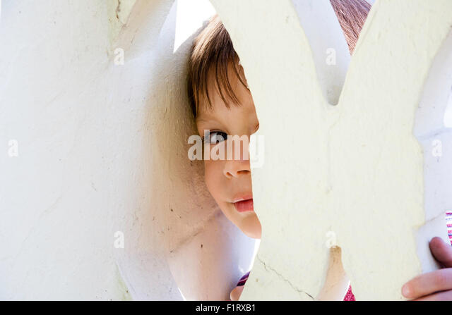 3 to 5 year old caucasian boy outdoor half hidden face peeking through gap - Hidden Pictures For 3 Year Olds