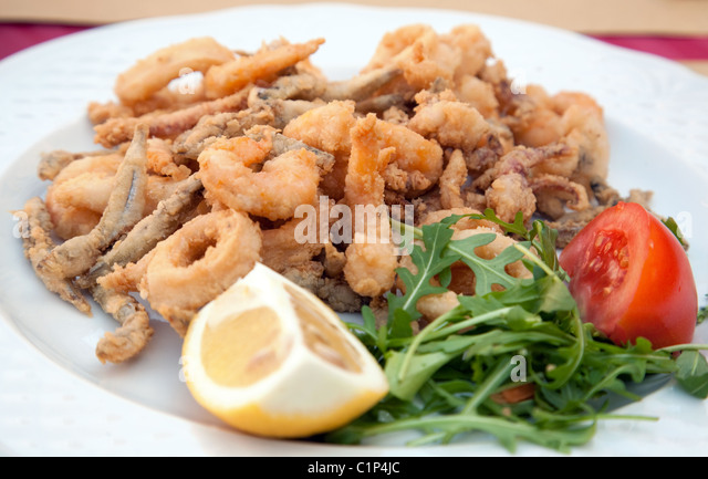 ... calamari fried battered squid rings seafood snack with aioli sauce