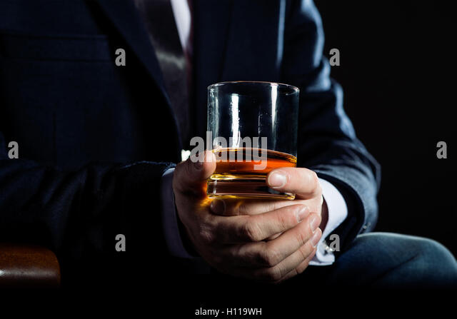 advantages of dating a business man with his cigar and whiskey photo