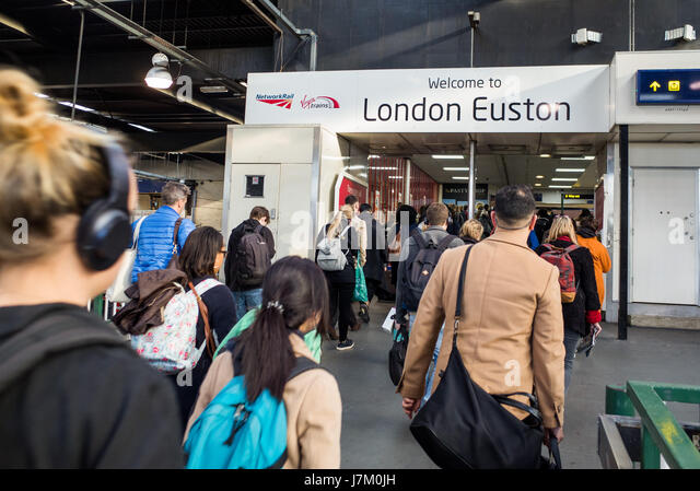 Passengers at London Euston Station UK - Stock Image