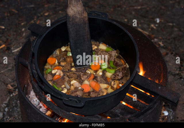 Dutch oven pot stock photos dutch oven pot stock images for How to cook in a dutch oven over a campfire