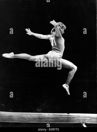 gymnast olga korbut jumps during competition stock image