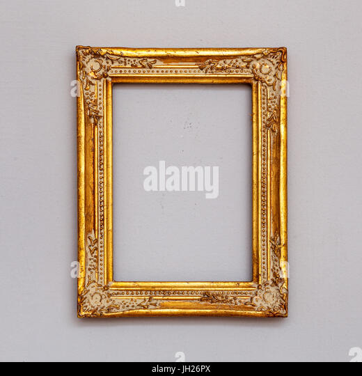 empty golden vintage picture frame on a wall stock image - Empty Picture Frame