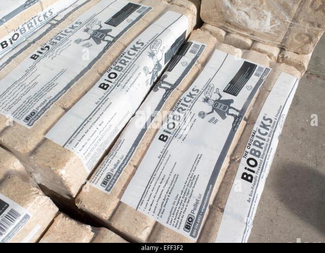 Compressed Wood Bricks ~ Wood burning stoves fireplace stock photos
