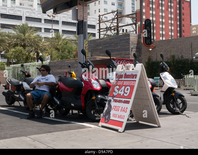 Scooter rental stock photos scooter rental stock images for Motorized scooter rental las vegas