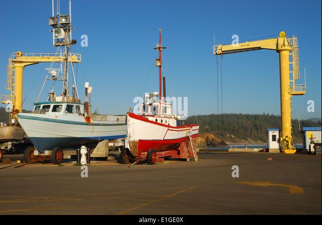 Boat crane dock marina stock photos boat crane dock for Boat lift motors near me