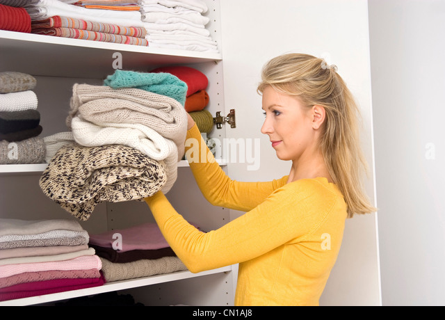 Put Clothes Away ~ Putting away laundry stock photos