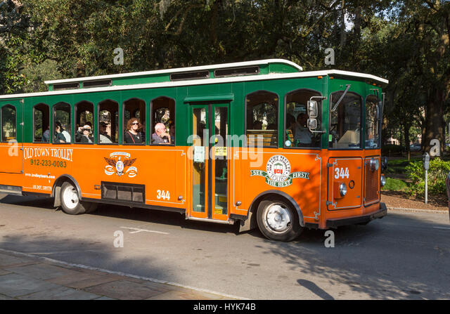 Old Town Trolley Tour Bus And Passengers