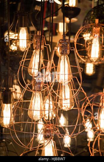 Decorative antique edison style filament light bulbs hanging - Stock Image