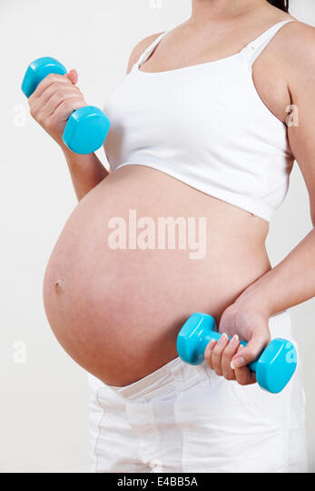 pregnant woman lifting weights stock photos amp pregnant