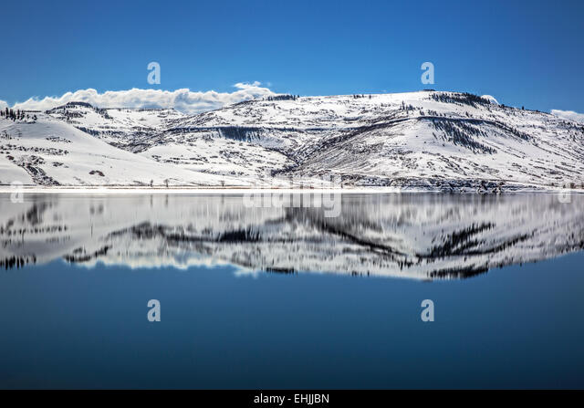 reflection-of-snowy-mountains-surroundin