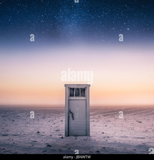 Magical and imagination scene with door and stars at night time - Stock Image