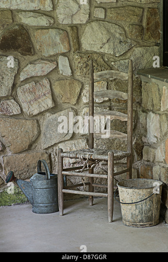 Old Chair Stone Wall Metal Bucket Watering Can
