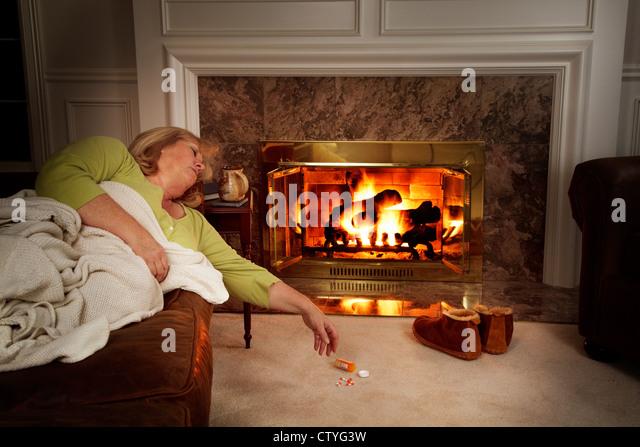 Woman Sleeping Fireplace Stock Photos & Woman Sleeping ...