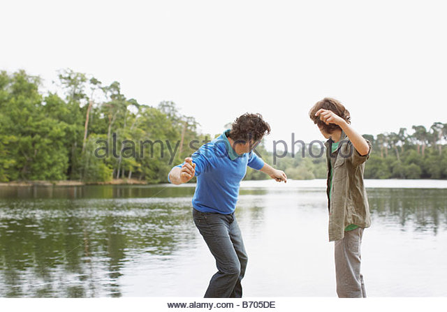 throwing rocks in water stock photos throwing rocks in water stock images alamy. Black Bedroom Furniture Sets. Home Design Ideas