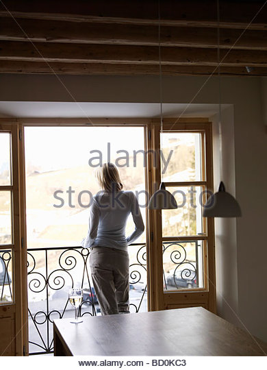 woman standing at open balcony door - Stock Image & Glass Door Balcony Stock Photos u0026 Glass Door Balcony Stock Images ... pezcame.com