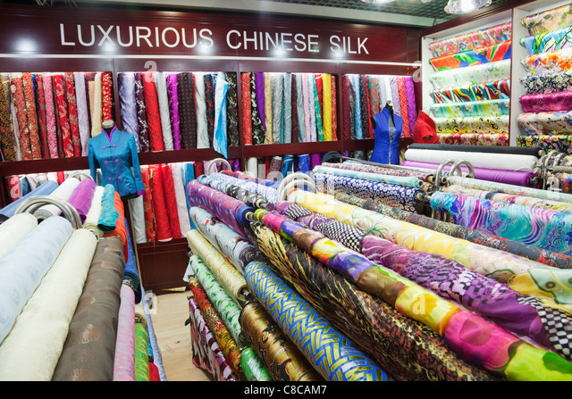 http://l7.alamy.com/zooms/550bba2b9c0541db91b1394accf0e9e2/china-beijing-the-silk-market-material-and-silk-shop-c8cam7.jpg