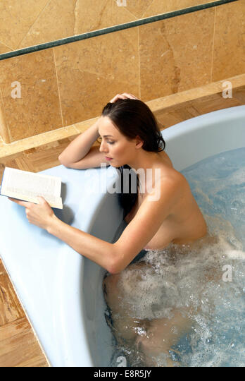 Woman In Jacuzzi Reading Book Beauty Bath Stock Photos & Woman In ...
