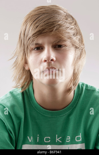 13-year-old-boy-wearing-a-green-t-shirt-and-looking-annoyed-b6f941.jpg