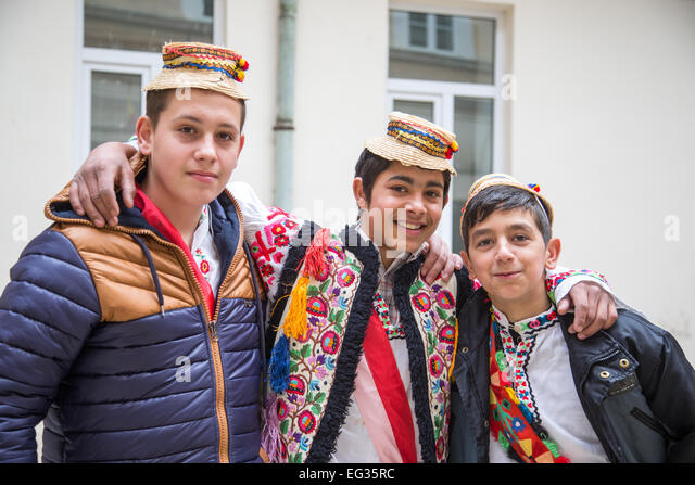 romanian people. romanian traditional costume in sigisoara transylvania with local people wearing felt and straw hats celebrating -