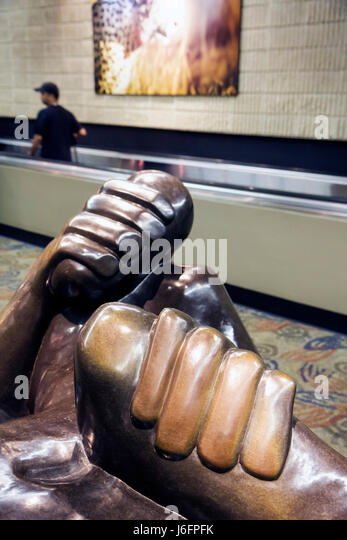 Atlanta Georgia Hartsfield-Jackson Atlanta Airport ATL African art exhibit sculpture public space passenger moving - Stock Image