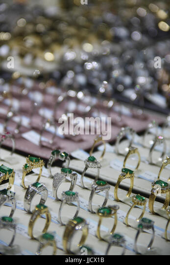 Beautiful rings made in silver and gold studded with exotic precious gemstones for sale. - Stock Image