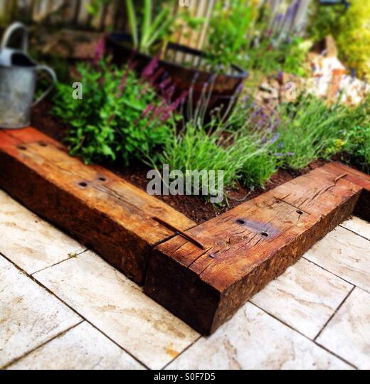 garden with old railway sleepers stock image