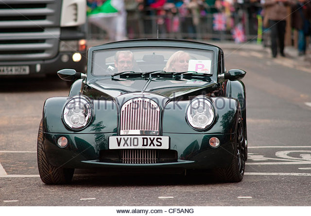 a morgan aero supersports car in the procession of the annual lord mayors show in the