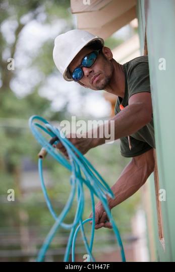 man holding hose stock  man holding hose stock