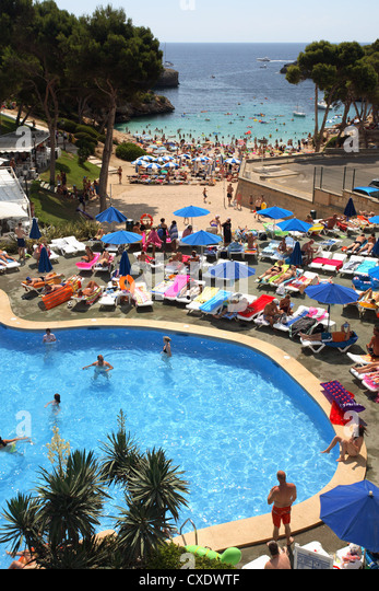 Hotel pool with people  Family Holiday Pool Hotel Stock Photos & Family Holiday Pool Hotel ...