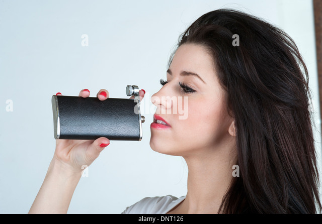 young-woman-drinking-from-a-hip-flask-dn