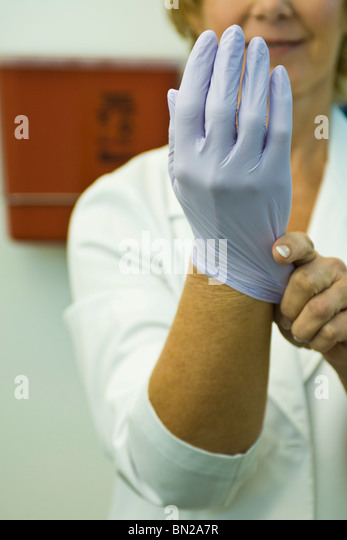 Putting On A Rubber Glove For Suck