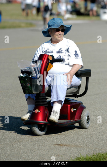 Powered wheelchair woman stock photos powered wheelchair for Motorized carts for seniors