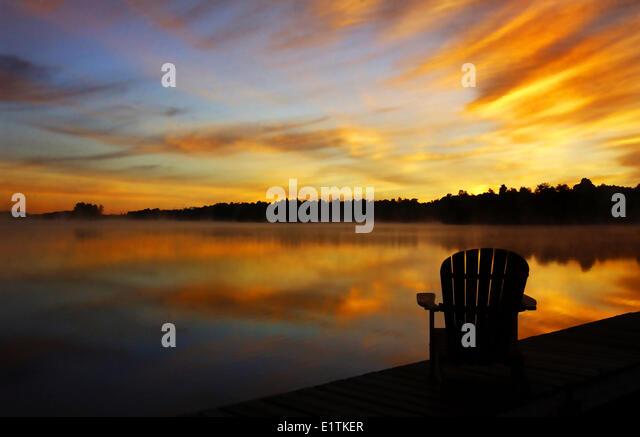 Adirondack Chair On Cottage Deck At Sunrise Sharbot Lake, Ontario, Canada    Stock Image