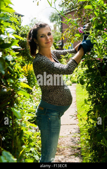 young woman gardening stock photos young woman gardening