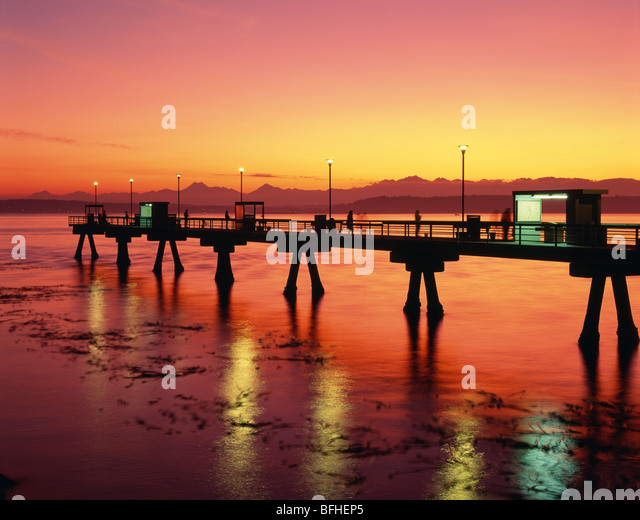 Sunset over puget sound olympic stock photos sunset over for Seattle fishing pier