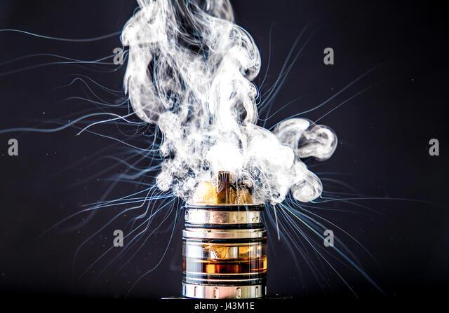 Dissassembled Electronic Cigarette vapour cloud - Stock Image