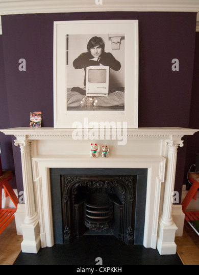 Upon A Fireplace Sits Framed Picture Of Steve Jobs