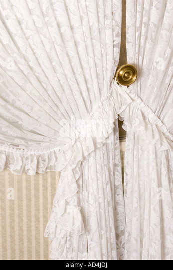 Detail Of Lace Curtains Drawn Back   Stock Image