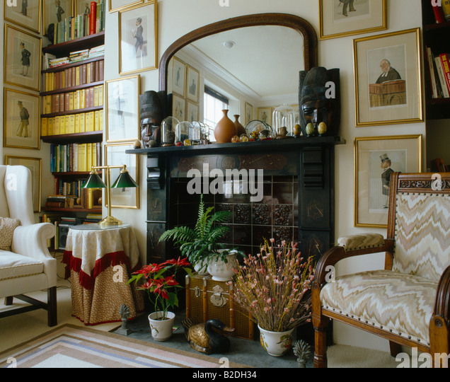 Pictures And Mirror Above Black Marble Fireplace In Traditional Living Room With Alcove Shelves Edwardian
