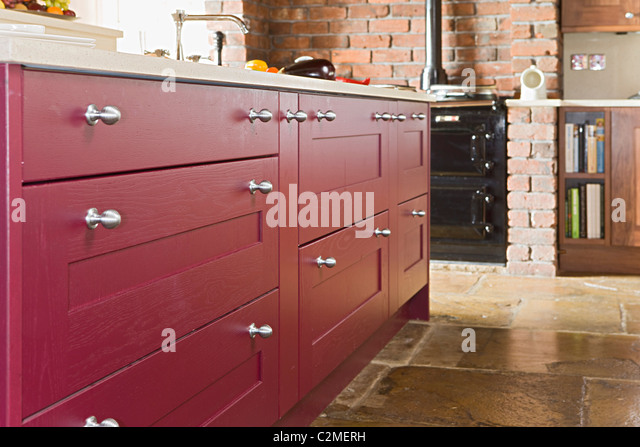 Traditional Frmhouse Kitchen With Flagstone Floor And Shaker Style  Cupboards And Drawers   Stock Image