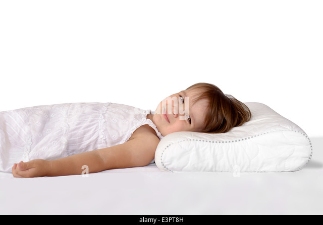 little girl sleeping on an orthopedic pillow stock image