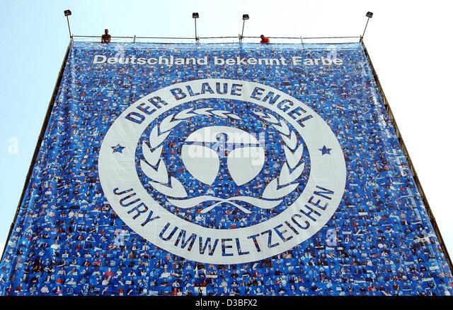 Huge poster with the blue angel logo is displayed at a house in berlin
