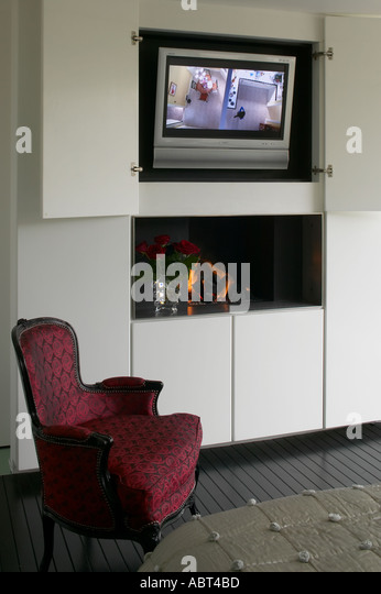 Refurbished House In Camden Town. Television Cabinet In Master Bedroom.  Architect: Munkenbeck And