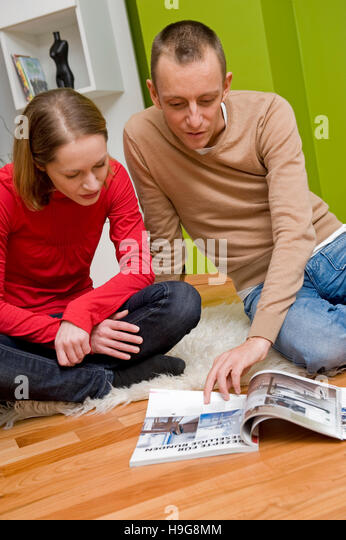 couple looking at mail order catalog stock image