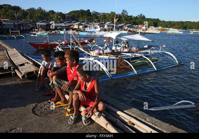Philippines children boats stock photos philippines for Sa fishing 5 for 15