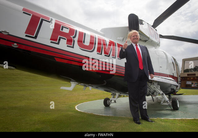 tycoon Donald Trump standing next to his private helicopter at Trump ...