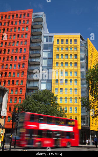 red london double decker bus passing by brightly colored office blocks stock image brightly colored offices central st