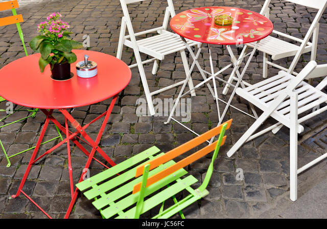 Colourful Modern Tables And Chairs For Outside Eating, With Ashtrays    Stock Image