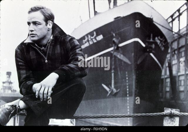 a review of the film on the waterfront directed by elia kazan in 1954 Reviews counted: 62  waterfront priest father barry (karl malden) tells terry  that edie's brother was killed  director elia kazan famously informed on  suspected communists before a government  all these years later elia kazan's  film about mob corruption in the dock workers' unions is still poignant and thrilling.